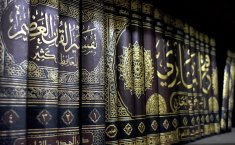 Which caliph officially ordered to compile hadith