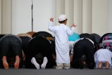 A-child-blocks-the-place-of-prostration.jpg